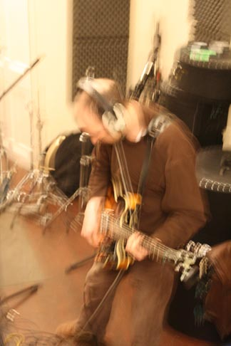Photo: Jim thrashing out the guitar parts.